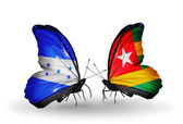Butterflies with Honduras and   Togo flags on wings — Stock Photo