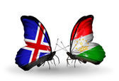 Butterflies with Iceland and Tajikistan flags on wings — Stockfoto