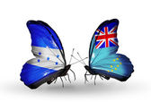 Butterflies with Honduras and  Tuvalu flags on wings — Stock Photo