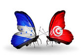 Butterflies with Honduras and  Tunisia flags on wings — Stock Photo