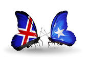 Butterflies with Iceland and Somalia flags on wings — Stockfoto