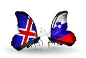 Butterflies with Iceland and  Slovenia flags on wings — Stockfoto