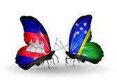 Butterflies with Cambodia and  Solomon Islands flags on wings — Stock Photo