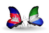 Butterflies with Cambodia and  Sierra Leone flags on wings — Stock Photo