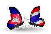 Motýli s kambodžou a thajskem vlajky na křídlech — Stock fotografie