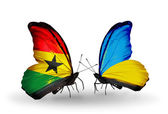 Butterflies with Ghana and Ukraine flags on wings — Stock Photo