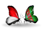 Butterflies with Monaco, Indonesia and Turkmenistan flags on wings — Stockfoto