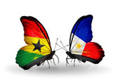 Butterflies with Ghana and Philippines flags on wings — Stock Photo