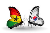 Butterflies with Ghana and South Korea flags on wings — Stock Photo