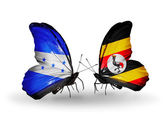 Butterflies with Honduras and  Uganda flags on wings — Stock Photo