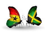 Motýli s příznaky ghana a jamajka na křídlech — Stock fotografie