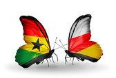Papillons avec le ghana et les drapeaux de l'ossétie du sud sur les ailes — Photo