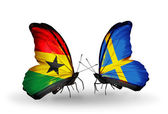 Butterflies with Ghana and Sweden flags on wings — Stockfoto