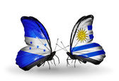 Butterflies with Honduras and  Uruguay flags on wings — Stock Photo