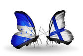Butterflies with Honduras and  Finland flags on wings — Stock Photo