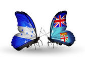 Butterflies with Honduras and  Fiji flags on wings — Stock Photo