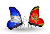 Butterflies with Honduras and  Montenegro flags on wings — Stock Photo