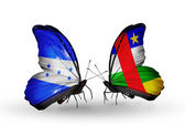 Schmetterlinge mit Honduras und Zentralafrikanische Republik Flaggen am Flügel — Stockfoto