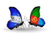 Butterflies with Honduras and  Eritrea flags on wings — Stock Photo