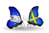 Butterflies with Honduras and  Sweden flags on wings — Stock Photo
