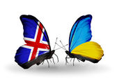 Butterflies with Iceland and Ukraine flags on wings — Stock Photo