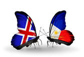 Butterflies with Iceland and Philippines flags on wings — Stock Photo
