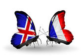 Butterflies with Iceland and  France flags on wings — Stock Photo