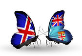 Butterflies with Iceland and Fiji flags on wings — Stockfoto