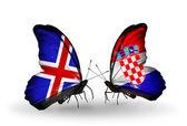 Papillons avec des drapeaux de l'islande et la croatie sur les ailes — Photo