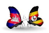 Papillons avec des drapeaux au cambodge et en ouganda sur les ailes — Photo