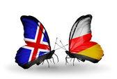 Papillons avec l'islande et les drapeaux de l'ossétie du sud sur les ailes — Photo