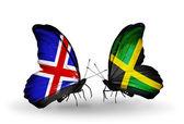 Fjärilar med island och jamaica flaggor på vingar — Stockfoto