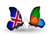 Butterflies with Iceland and Eritrea flags on wings — Stock Photo