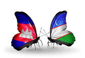 Butterflies with Cambodia and  Uzbekistan flags on wings — Stockfoto