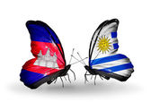 Butterflies with Cambodia and  Uruguay flags on wings — Stockfoto
