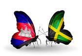 Papillons avec des drapeaux au cambodge et de la jamaïque sur les ailes — Photo