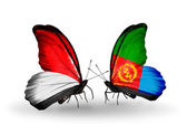 Butterflies with Monaco, Indonesia and Eritrea flags on wings — Stock Photo