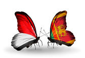 Butterflies with Monaco, Indonesia and Sri Lanka flags on wings — Photo
