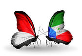 Butterflies with Monaco, Indonesia and Equatorial Guinea flags on wings — Stock Photo