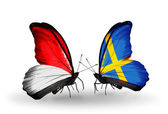 Butterflies with Monaco, Indonesia and  Sweden flags on wings — Stockfoto