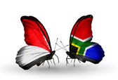 Butterflies with Monaco, Indonesia and  South Africa flags on wings — Stockfoto