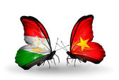 Butterflies with Tajikistan and Vietnam flags — Stock Photo