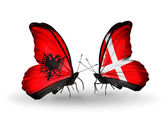 Butterflies with Albania and Denmark flags — Stock Photo