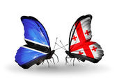 Butterflies with Botswana and Georgia flags — Stock Photo