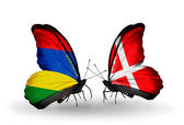 Butterflies with Mauritius and Denmark flags — Stock Photo