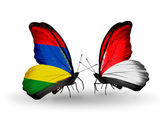 Butterflies with Mauritius and Monaco, Indonesia flags — Stock Photo