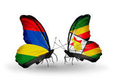 Butterflies with Mauritius and Zimbabwe flags — 图库照片