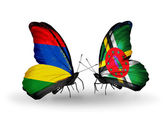 Butterflies with  Mauritius and Dominica flags — Stock Photo