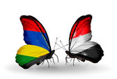 Butterflies with Mauritius and Yemen flags — Stock Photo