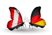 Borboletas com bandeiras do peru e alemanha — Fotografia Stock